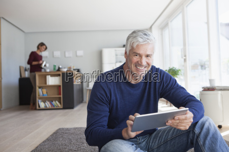 portrait of smiling man sitting on