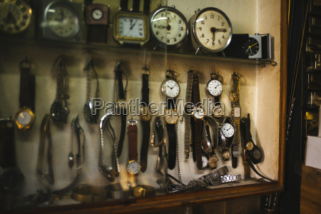 antique clocks displayed on watchmaking workshop