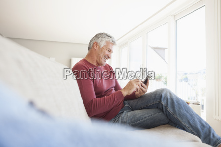 smiling man sitting on the couch