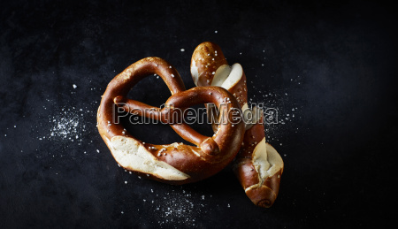 pretzel and pretzel roll on dark