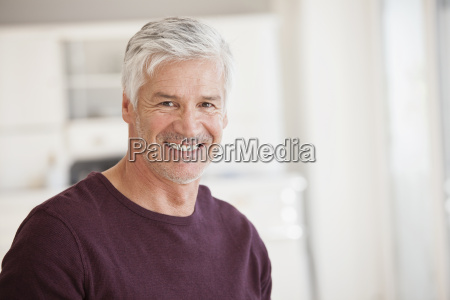 portrait of smiling mature man grey