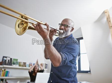 portrait of man playing trombone at