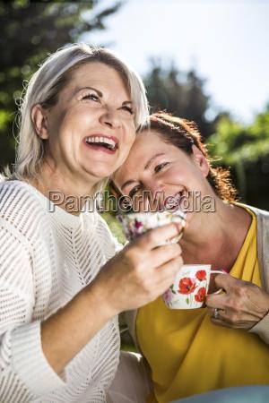 happy mature women in garden with