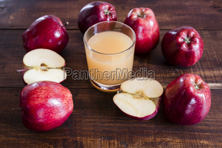 whole and sliced red apples and