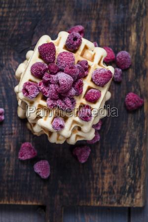 belgian waffle with frozen raspberries