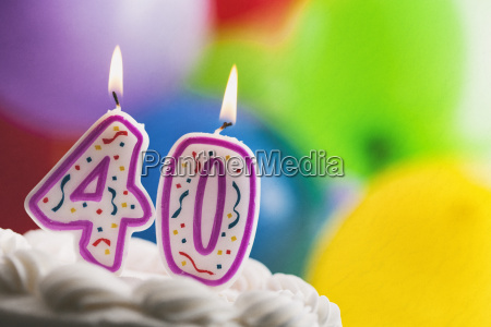 lighted birthday candles on a cake