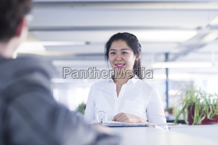 chinese office worker working in customer