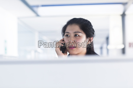 chinese office worker working in corporate