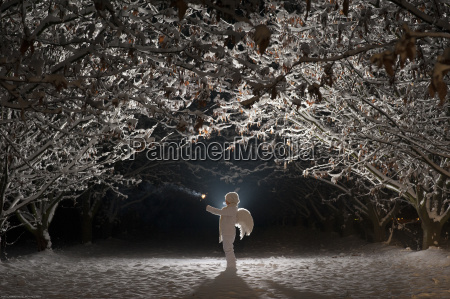 white dressed child with angel wings