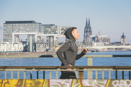 germany cologne young man running at