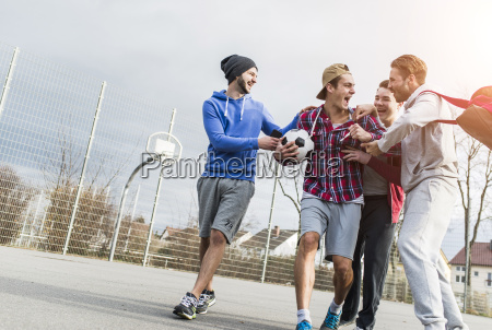 four young football players