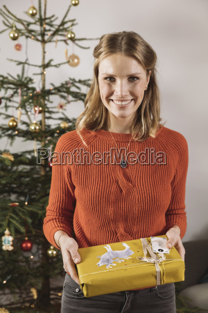 portrait of woman with christmas gift