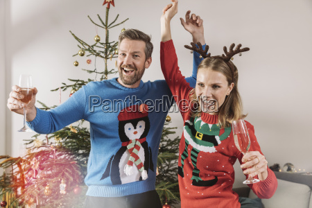two people with ugly christmas sweaters