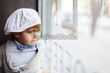portrait of angry little boy with