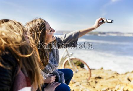 spain gijon two young women taking