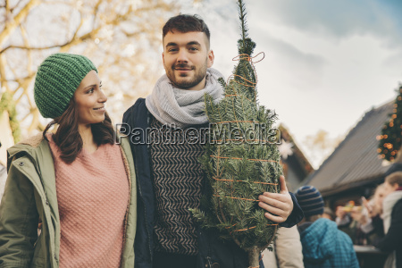 happy couple with a tree on