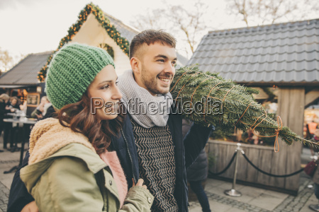 happy couple with a tree walking