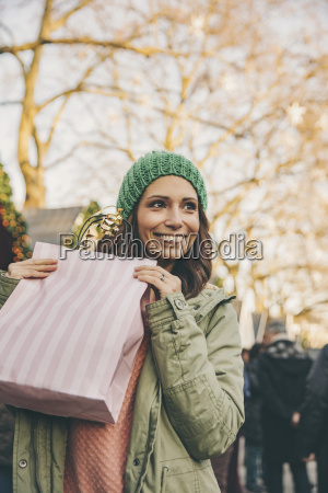 happy woman holding a gift bag