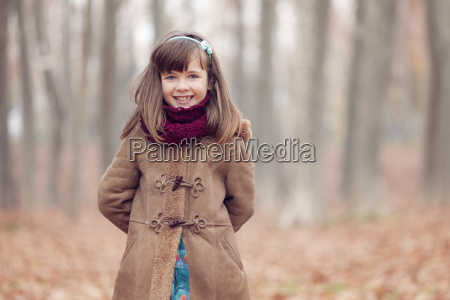 young girl brown coat in park