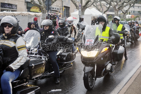 bikers driving in heavy rain