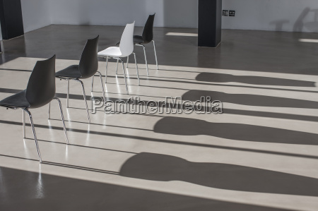 row of chairs in empty office