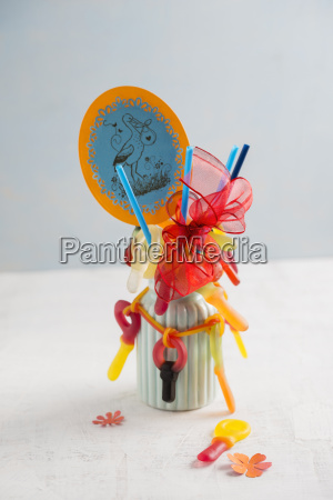 bouquet with gum pacifiers on straws