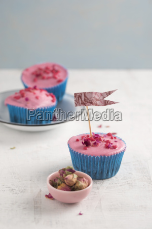 cupcake with candied rose blossoms dried