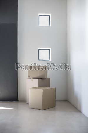 cardboard boxes in a corner