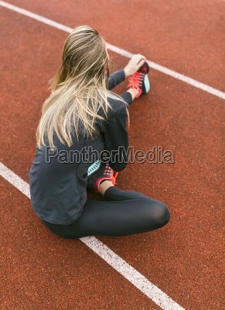 spain female runner worming up