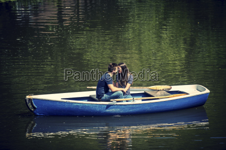 lovers in rowing boat on water