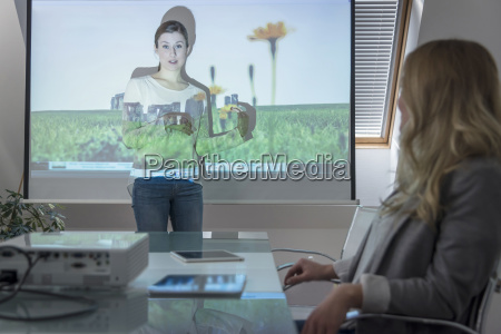 woman leading a presentation with projector