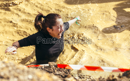 participants in extreme obstacle race running