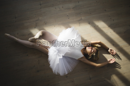 ballerina in a tutu lying on