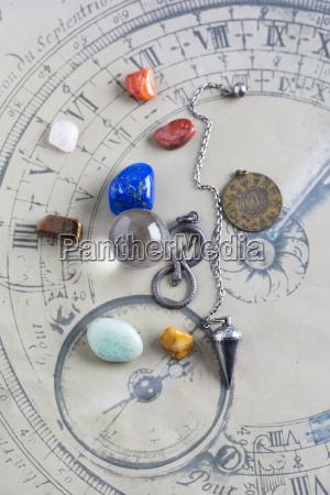 semiprecious stones pendulum pendant and crystal