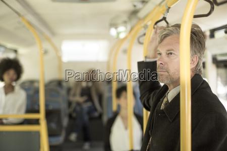 mature man taking city bus
