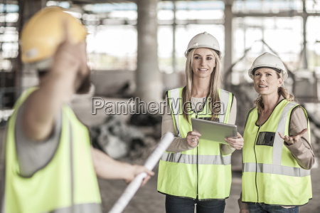 two women in protective workwear and