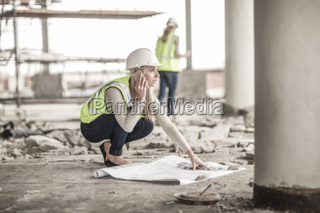 woman in protective workwear on cell
