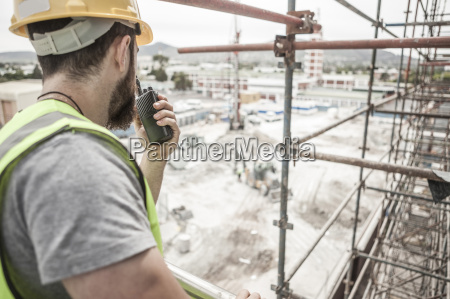 construction worker with walkie talkie in
