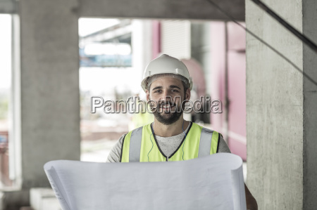portrait of smiling construction worker with