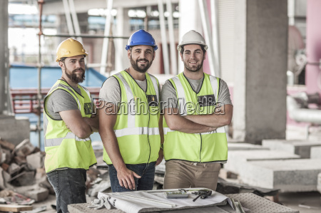 portrait of confident construction workers in