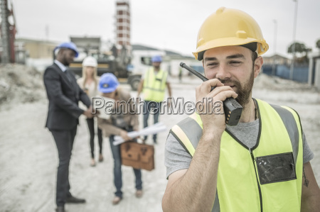 construction worker with walkie talkie on