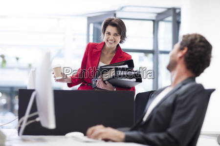 businesswoman in office with file folders