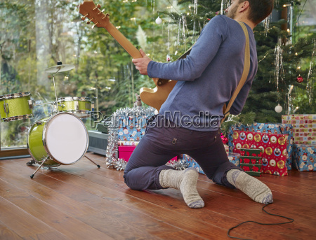 man playing electric guitar in front