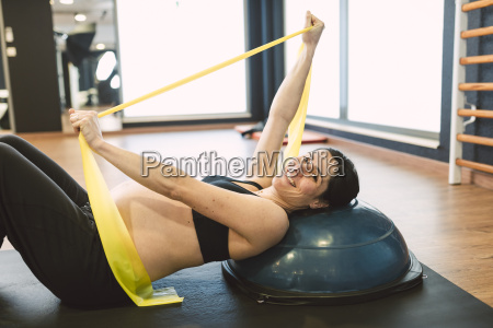 pregnant woman doing pilates exercises with