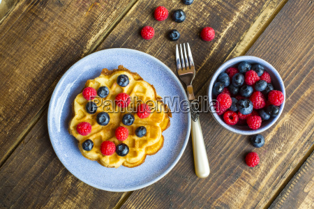 waffle with blueberries and raspberries on