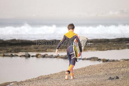 spain tenerife boy walking on beach
