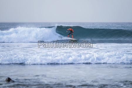 spain tenerife boy surfing on ocean