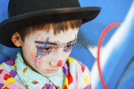 portrait of sad boy rouged as