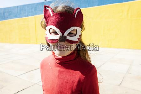 portrait of little girl wearing animal
