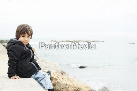 portrait of little boy sitting on